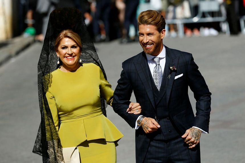 Ramos walks next to his mother Paqui Garcia at his wedding.