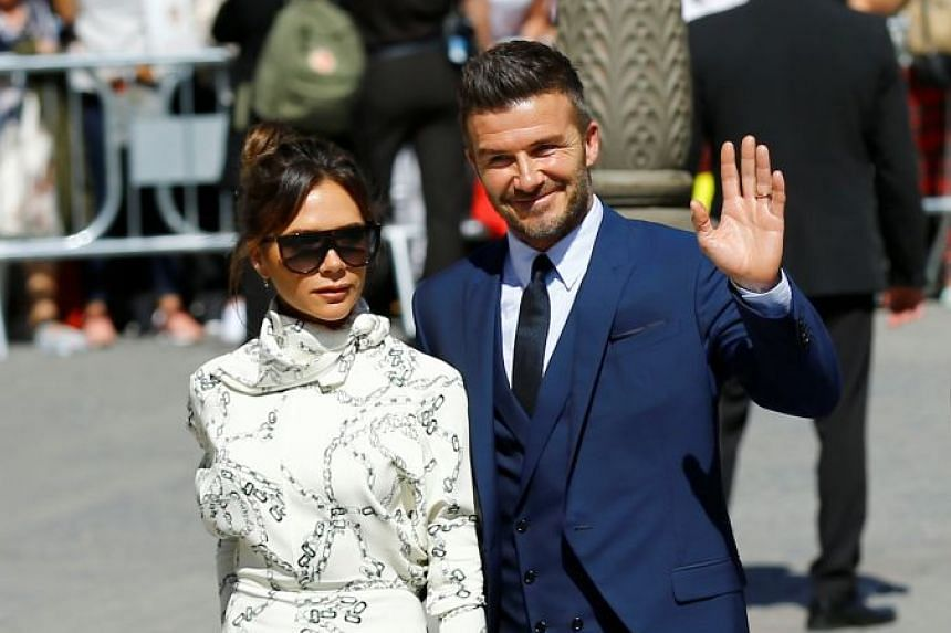 David Beckham and his wife Victoria attend the wedding.