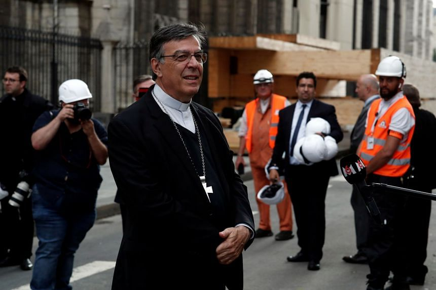 Archbishop of Paris Michel Aupetit leaves Notre-Dame after taking part in the mass.