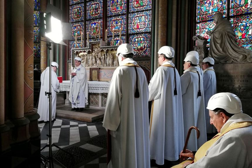 Archbishop of Paris Michel Aupetit leads the first mass in a side chapel two months to the day after a devastating fire engulfed the Notre-Dame.