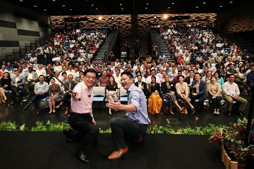 DPM Heng Swee Keat taking a wefie for his maiden Instagram post with Reach-CNA dialogue moderator Steven Chia at SMU's School of Law yesterday. Mr Heng launched his Instagram account at the end of the dialogue.