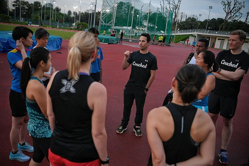 Former professional triathlete Ben Pulham (centre, during a recent training session) will be helming The Straits Times Run's coaching series this year.
