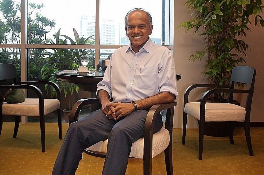 He's always loved dogs, says Mr Shanmugam, and he had them before he became a minister. He currently has four rescue dogs including Eligh (on his lap) and Samson (next to him). Mr K. Shanmugam took a big pay cut when he moved from the private sector