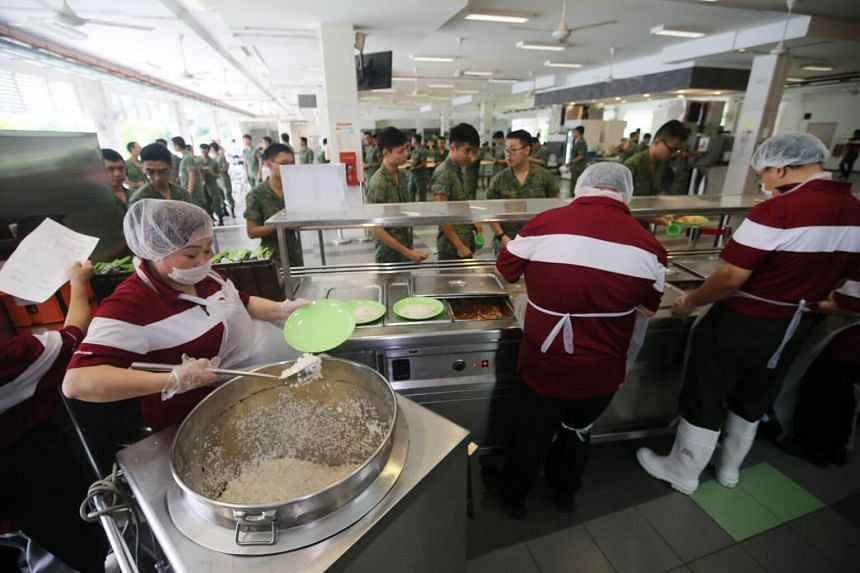Soldiers at a cookhouse in Kranji Camp III.