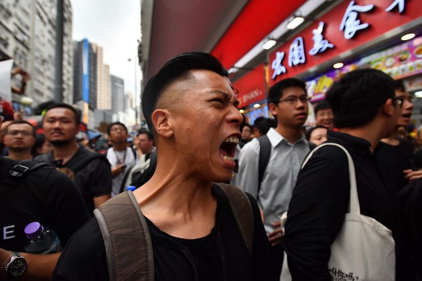 A demonstrator shouting during a protest against a controversial extradition Bill, in Hong Kong on June 16, 2019.