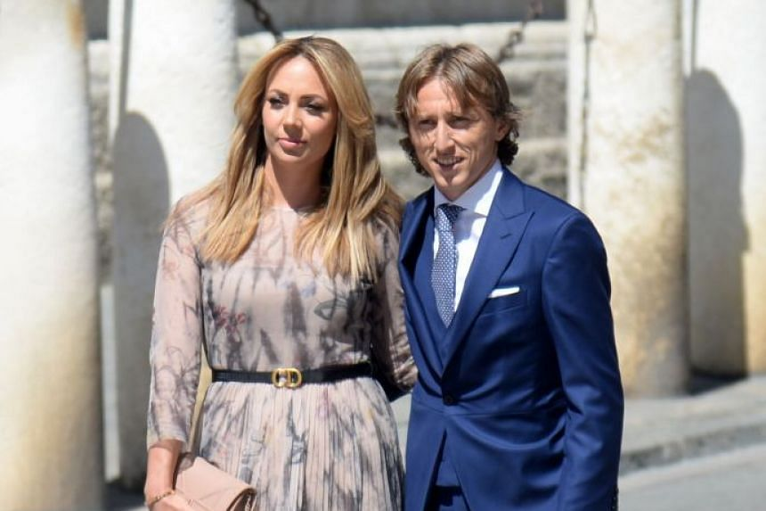 Real Madrid's Croatian midfielder Luka Modric and his wife Vanja Bosnic arrive at the cathedral.