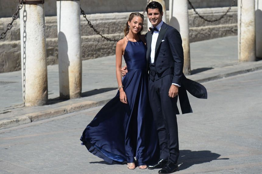 Spain's forward Alvaro Morata and his wife Alice Campello arrive at the cathedral.