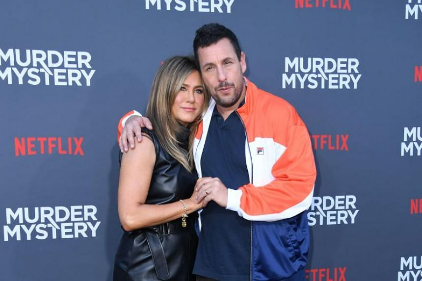 Jennifer Aniston and Adam Sandler posing at the premiere screening of the Netflix film Murder Mystery at the Regency Village Theatre in LA on June 10, 2019.