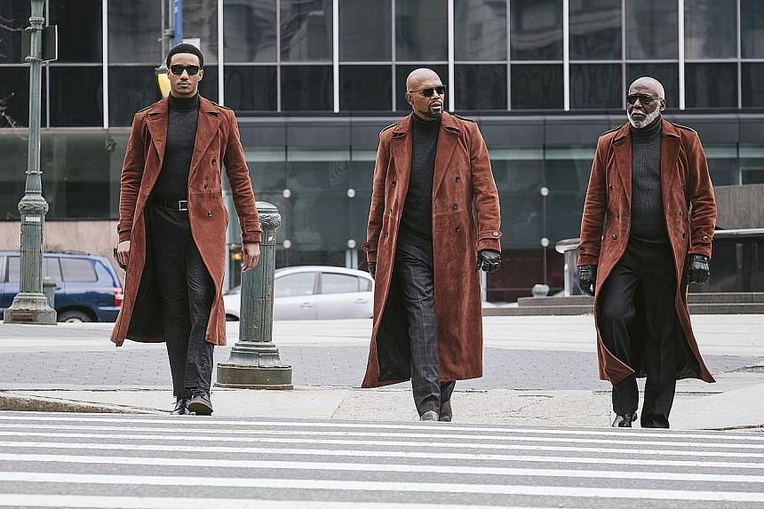 Richard Roundtree returns as a snowy-haired and sailor-mouthed grandfather in the new Shaft movie, starring (above, from left) Jessie T. Usher, Samuel L. Jackson and himself.
