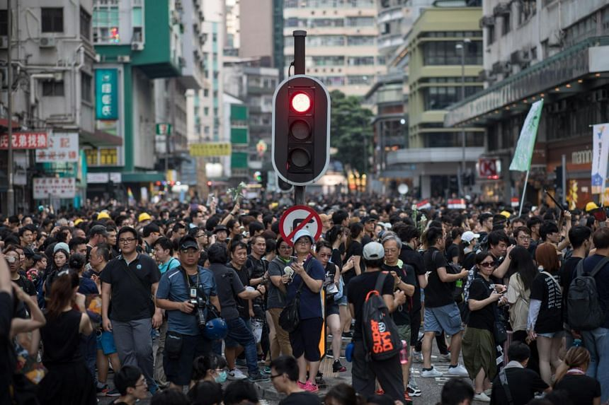 Protesters take part in a rally to demand a complete withdrawal of an extradition bill in Hong Kong, China, on June 16, 2019.