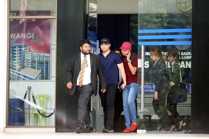 Haziq Aziz (centre), who claims to be one of the two individuals in the viral sex video, leaving the Dang Wangi police station in Kuala Lumpur on June 15, 2019.