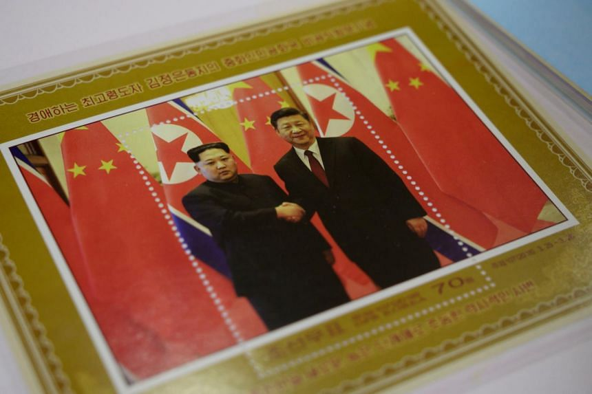 A commemorative stamp featuring a meeting between North Korean leader Kim Jong Un and Chinese President Xi Jinping at a shop in Pyongyang on June 18, 2019.
