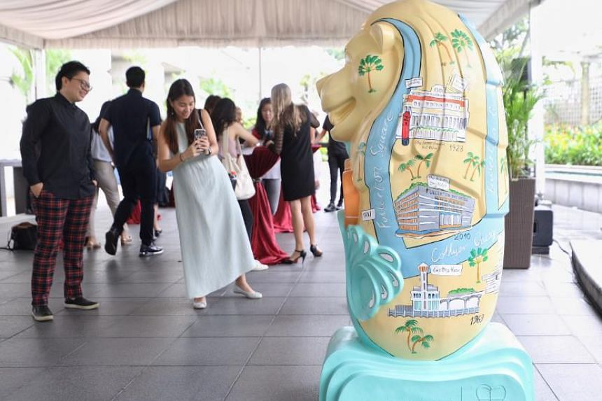 The Fullerton Hotels' Merlion is painted with a map of iconic landmarks in the precinct.