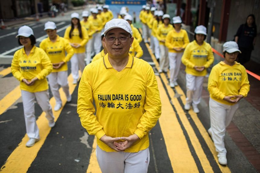 Supporters of the Falun Gong spiritual movement, a group banned in mainland China, take part in a march in Hong Kong on April 27, 2019. A tribunal says it has found that China is murdering members the spiritual group and harvesting their organs for t