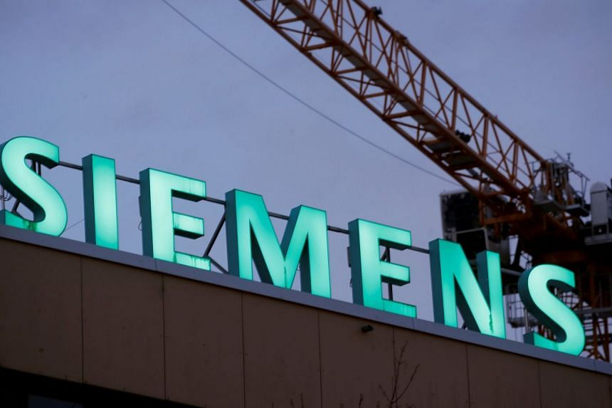Logo of German industrial group Siemens in Zurich. The conglomerate has announced more job cuts.
