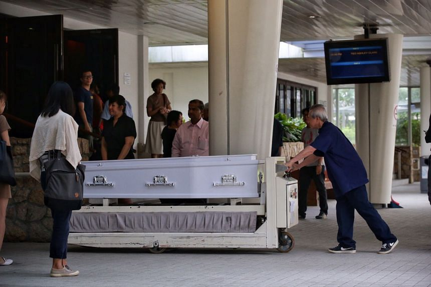 The body of a two-year-old child arrives at Mandai Crematorium for cremation on June 18, 2019.