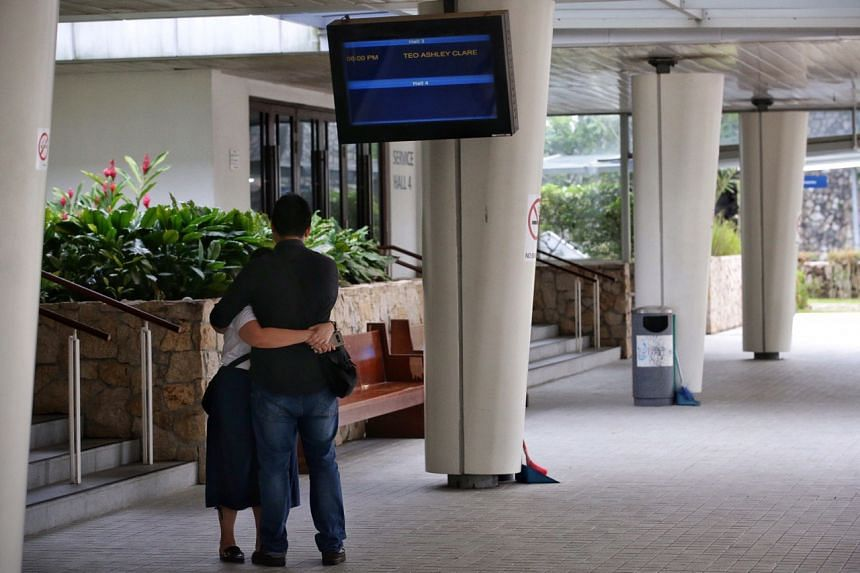 Family members of the two-year-old child grieving at Mandai Crematorium on June 18, 2019.