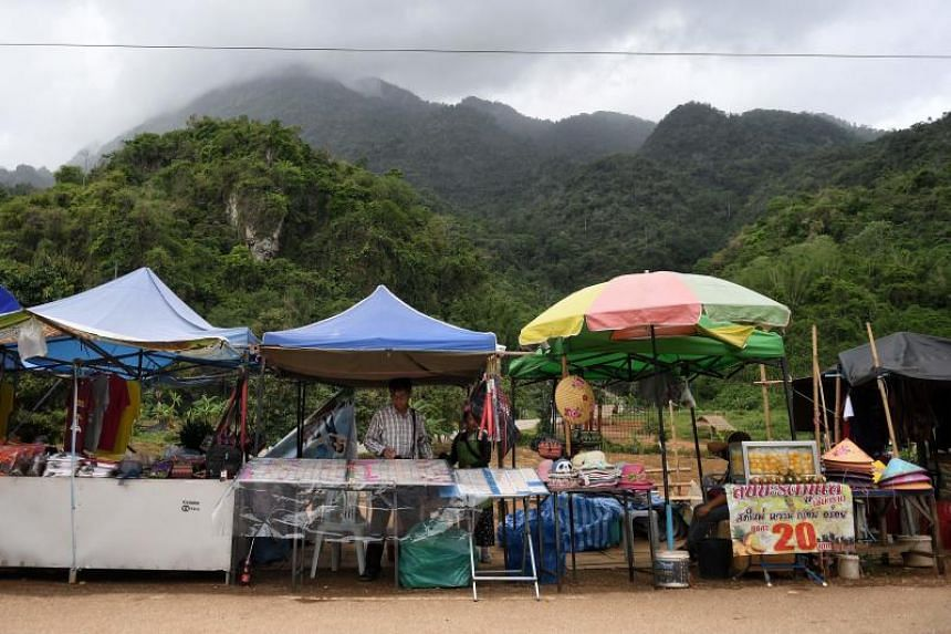 Stalls along the road leading to the Tham Luang cave.