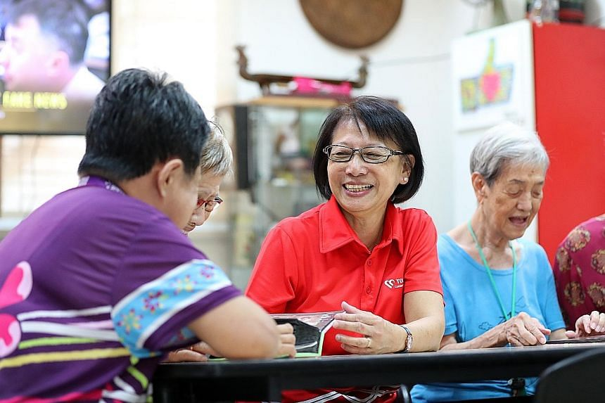 In 2006, Madam Yong Yin Hoong (in red) accepted a hefty pay cut to join Touch Senior Activity Centre in Geylang Bahru, which looks after the welfare of the area's seniors, many of whom live in rental apartments. She is now an assistant manager there.