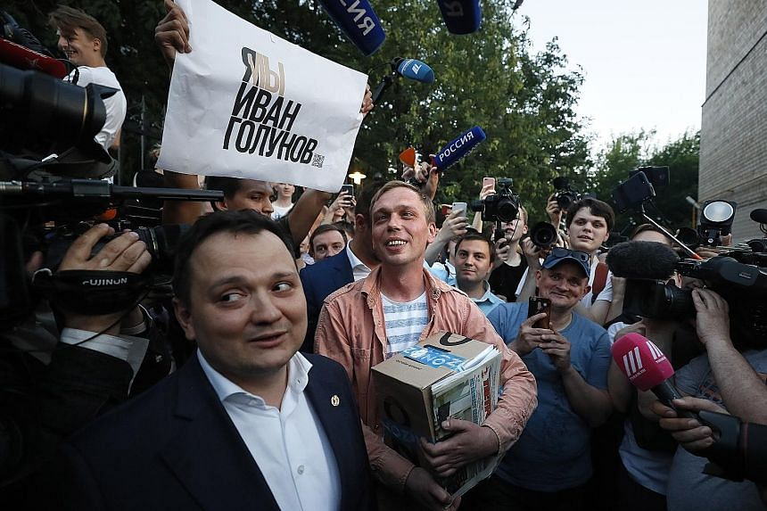Russian journalist Ivan Golunov (centre) leaving the Russian Interior Ministry's Main Investigative Directorate in Moscow last week. He was released after nearly a week under house arrest over drug allegations, following an unprecedented show of prot