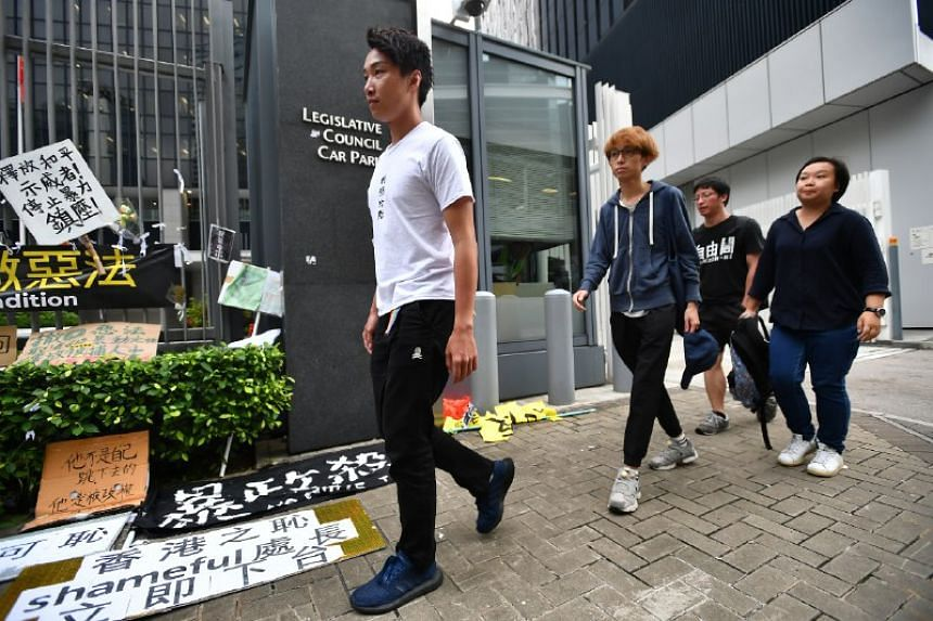 """Asked if the group would join in the """"escalation"""" and """"civil disobedience"""" threatened by students, Civil Human Rights Front (CHRF) convenor Jimmy Sham (left) replied that CHRF would need to find out more before making any commitments."""