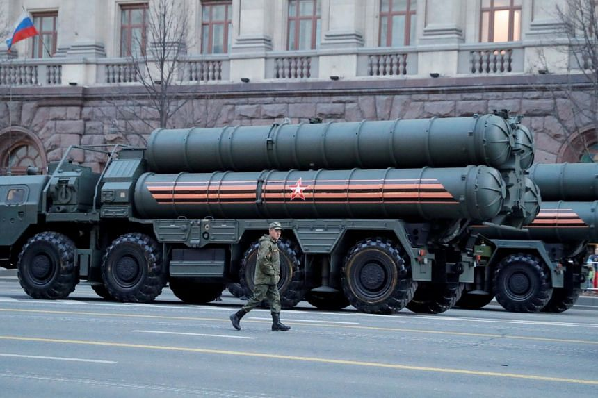 A Russian serviceman walks past S-400 missile air defence systems before a parade in central Moscow, Russia, on April 29, 2019.