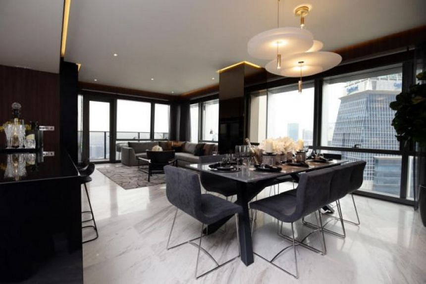 """The biggest of these """"super penthouses"""" in Singapore spans levels 62 to 64 of Wallich Residence, with a floor area of 21,108 sq ft and a building height of 950 ft."""