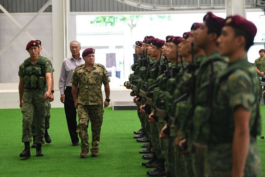 Jordanian King Abdullah II, accompanied by Defence Minister Ng Eng Hen, reviewing a Welcome Guard at Pasir Ris Camp on June 19, 2019.