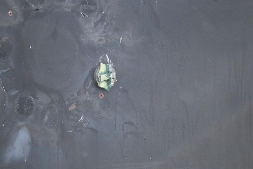 Remnants of a removed limpet mine's placement, location, and damage sustained from a limpet mine attack, on the starboard side of Japanese-owned tanker Kokuka Courageous, at sea outside of Fujairah, United Arab Emirates.