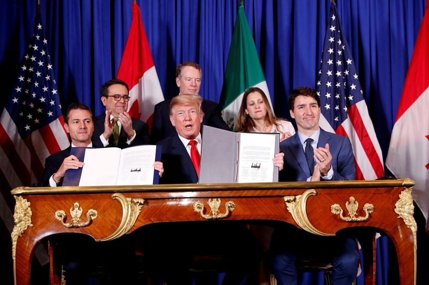 US President Trump, Canada's Prime Minister Justin Trudeau and Mexico's then-president Enrique Pena Nieto attend the USMCA signing ceremony in November 2018.