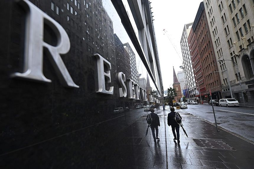 The Reserve Bank of Australia cut interest rates for the first time in three years earlier this month. It lowered its cash rate by 25 basis points to 1.25 per cent. PHOTO: AGENCE FRANCE-PRESSE