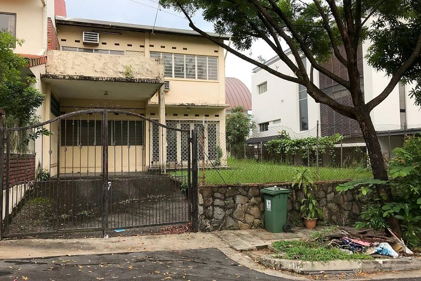 A house in Lorong Pisang Emas, a neighbourhood identified as a dengue cluster previously, that appears to have been left vacant. It was one of at least six vacant houses seen in the estate yesterday - some of which had overgrown weeds and empty flowe