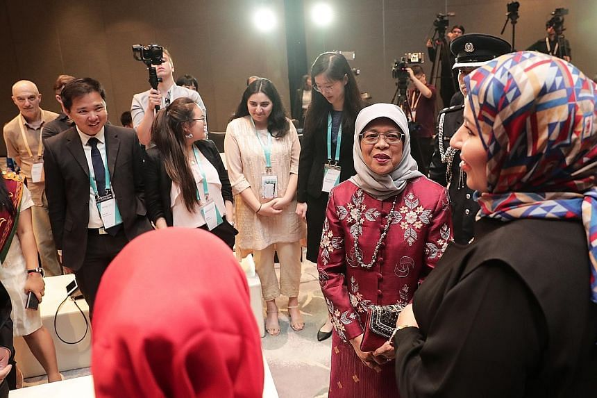 President Halimah Yacob meeting young people working to address challenges of social cohesion in their communities, on the sidelines of the International Conference on Cohesive Societies last night. Around 1,000 academics, government officials and me