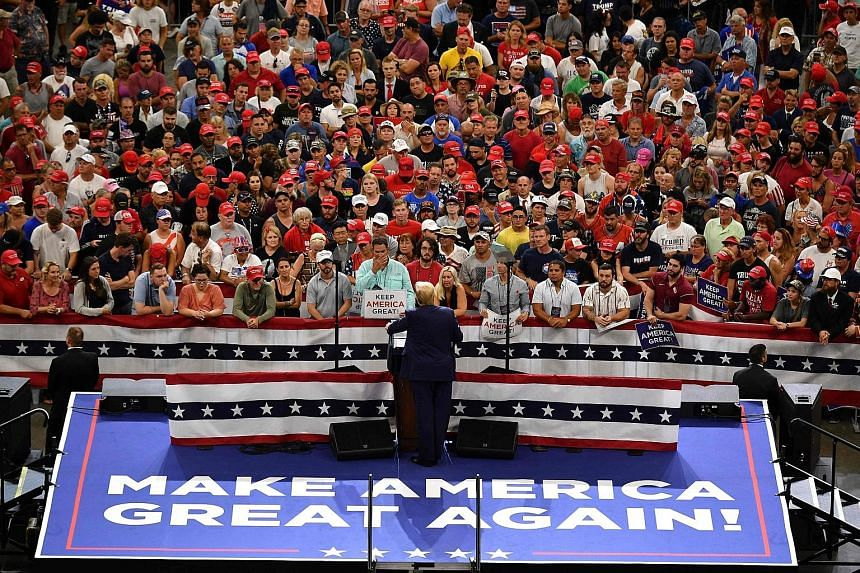 US President Donald Trump speaking during a rally at the Amway Centre in Orlando, Florida, on Tuesday to officially launch his 2020 campaign. The results of an independent poll released on that day showed Mr Trump trailing former Democrat vice-presid