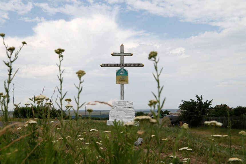 A cross is seen near the crash site of Malaysia Airlines flight MH17 outside the village of Hrabove in Donetsk Region, Ukraine, on June 19, 2019.