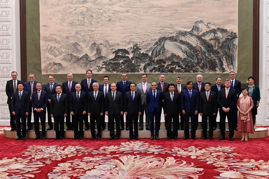 Chinese Premier Li Keqiang (front, centre) with representatives of the 7th Round-Table Summit of Global CEO Council at the Great Hall of the People in Beijing on June 20, 2019.