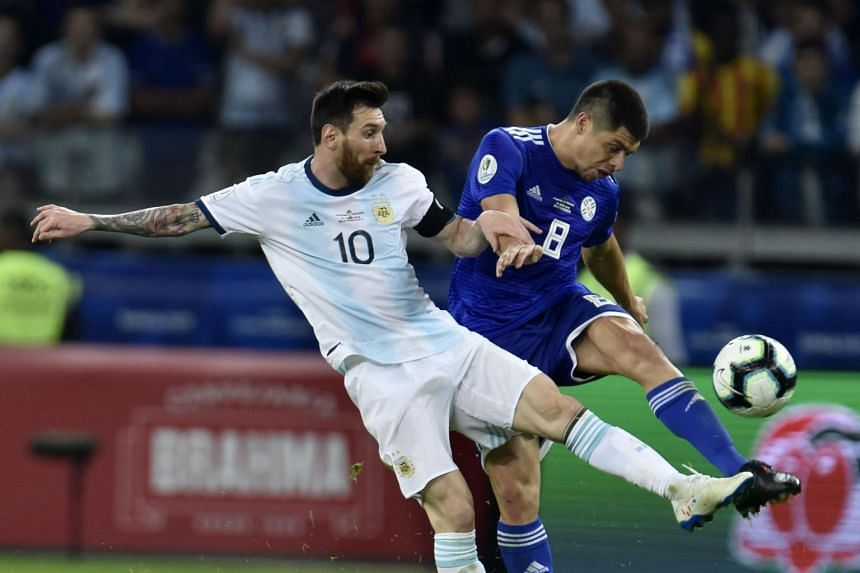 Argentina's Lionel Messi (left) and Paraguay's Rodrigo Rojas vie for the ball during their Copa America football tournament group match at the Mineirao Stadium in Belo Horizonte, Brazil, on June 19, 2019.