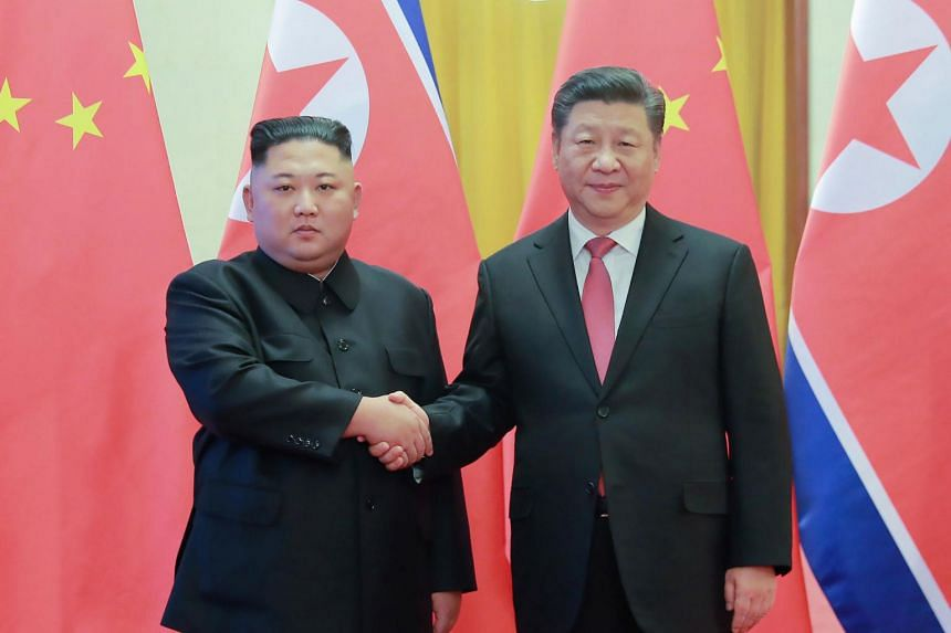 North Korean leader Kim Jong Un (left) and China's President Xi Jinping during a welcome ceremony at the Great Hall of the People in Beijing on Jan 8, 2019.