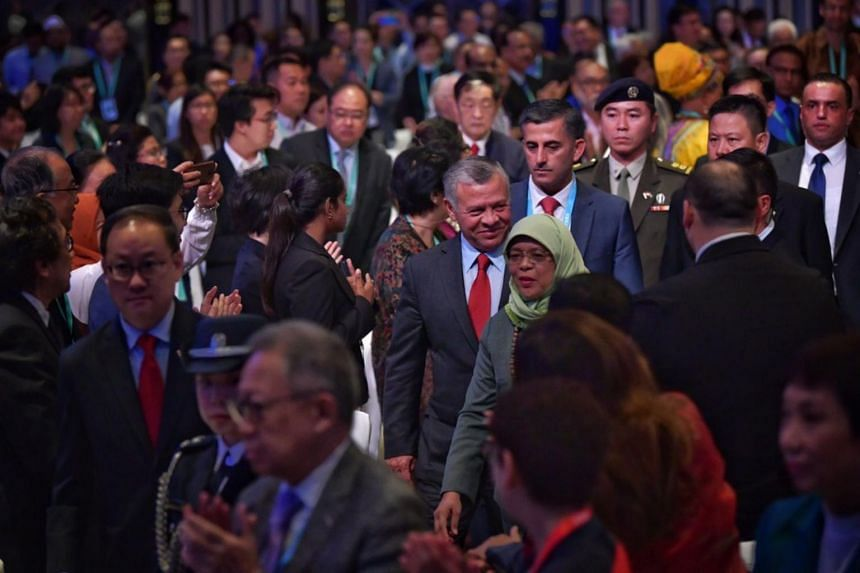 Jordan's King Abdullah II arriving with President Halimah Yacob at the inaugural International Conference on Cohesive Societies at Raffles City Convention Centre on June 20, 2019.
