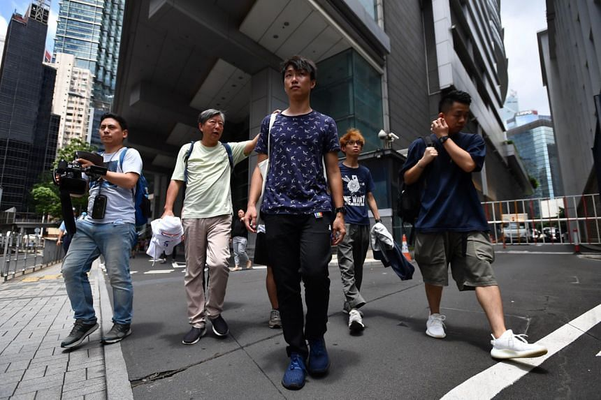 The Civil Human Rights Front holds a press conference outside Hong Kong Police Headquarters at 1 Arsenal Street on June 20, 2019.