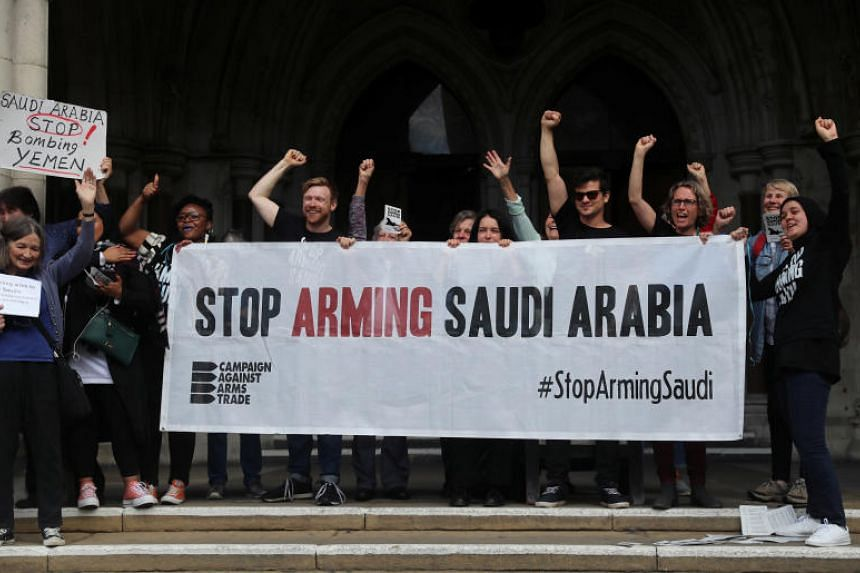 Demonstrators outside the Court of Appeal after the judgment of a legal battle by campaigners to challenge the UK government's decision to grant licences for the export of arms to Saudi Arabia in London.