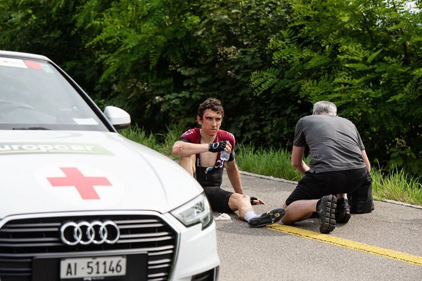 Team Ineos rider and Tour de France champion Geraint Thomas receiving treatment after falling during the Tour de Suisse on Tuesday. PHOTO: EPA-EFE
