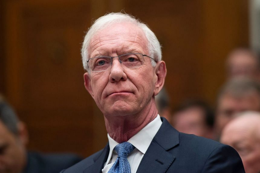 "Former airline captain Chesley ""Sully"" Sullenberger looks on during the hearing."