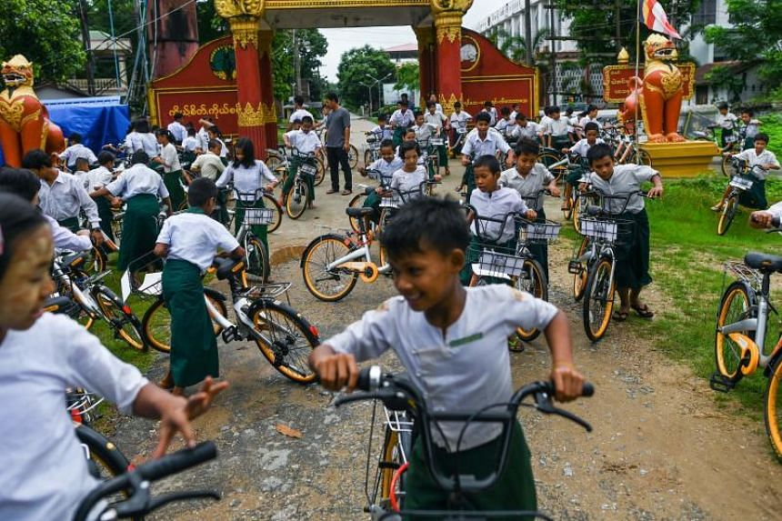 Recycled bikes were shipped from Singapore and Malaysia to give school children in Myanmar easier access to education.