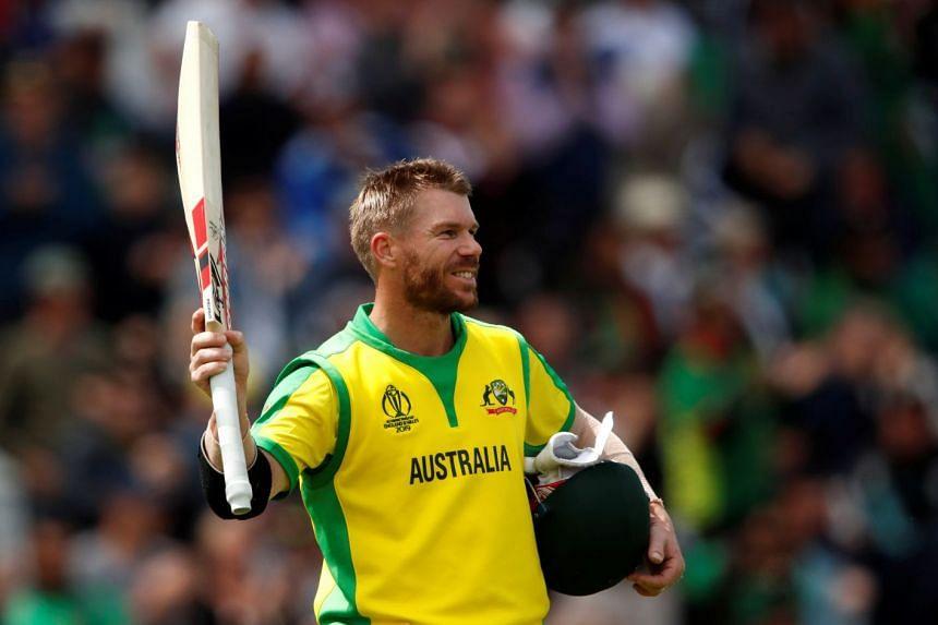 Australia's David Warner walks off after losing his wicket.