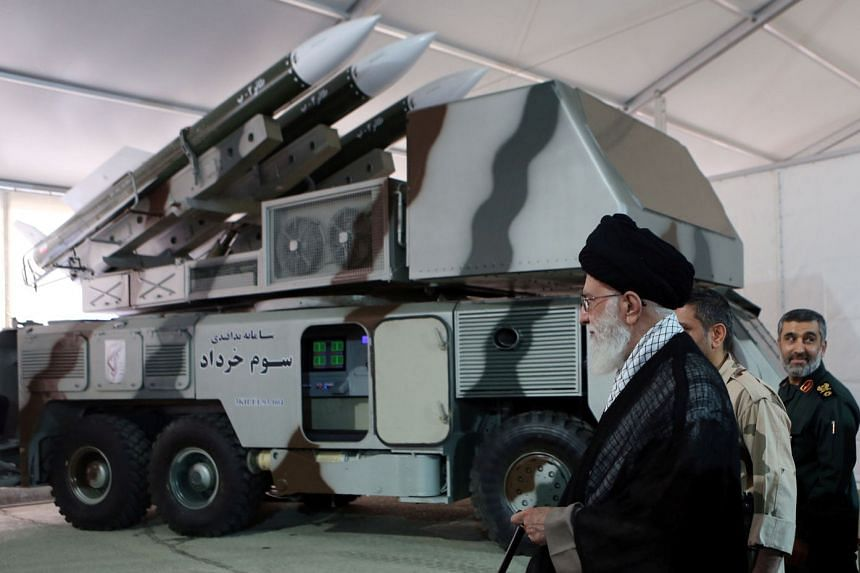"Iran's Supreme Leader Ayatollah Ali Khamenei is seen near a ""3 Khordad"" system, which is said to had been used to shoot down a US military drone."