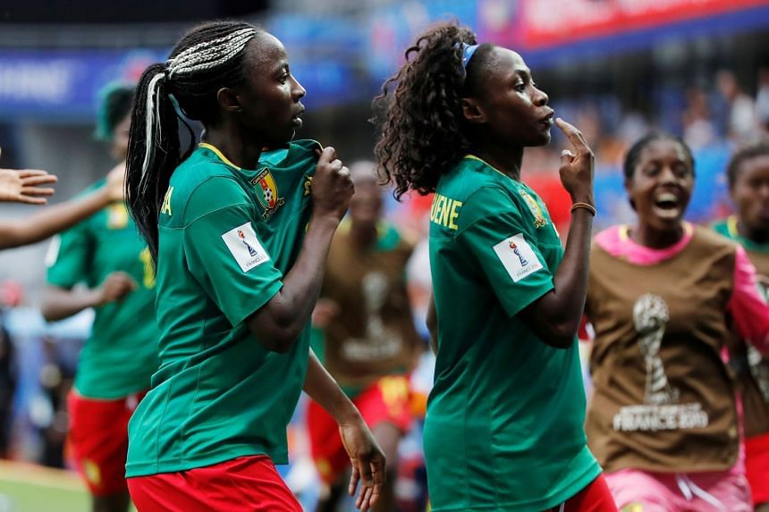 Cameroon's Ajara Nchout celebrates scoring their first goal with team mates.
