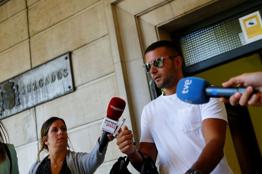 """Angel Boza, a member of the group known as La Manada (""""The Wolf Pack""""), exits a courthouse in Seville, Spain, June 21, 2019."""
