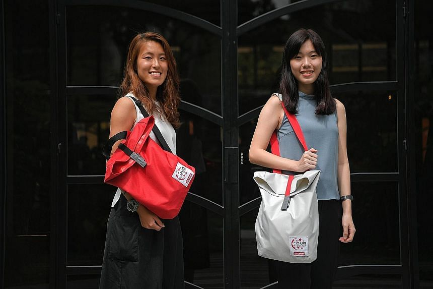 Left: The items in this year's NDP fun packs include reusable items such as bamboo straws that double as clappers and a 750ml water bottle, as well as NDP staples such as face tattoos and a miniature flag. Below: The bags come in red or white and fea