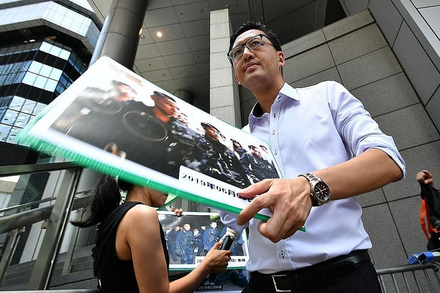 Hong Kong Democratic Party legislator Lam Cheuk-ting holding a press conference outside the Police Headquarters in Hong Kong yesterday.